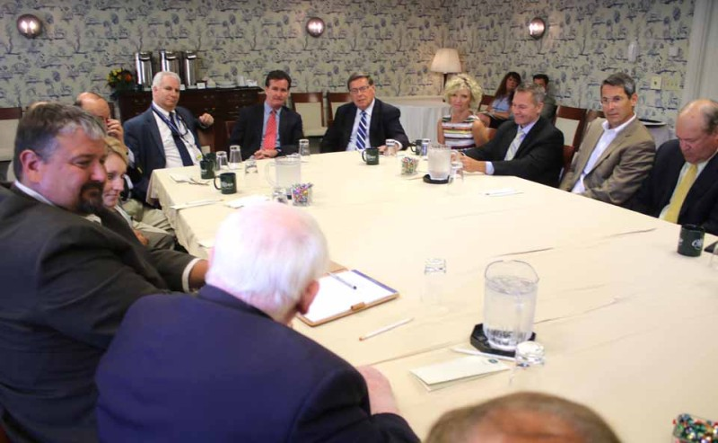 Frank Leo, proprietor of the Tunnicliff Inn, Cooperstown's oldest business, tells Majority Leader Flanagan (at head of table) that the same type of attention to detail businesspeople apply to their enterprises is needed to reduce the cost of education.  Clockwise from Leo's left are