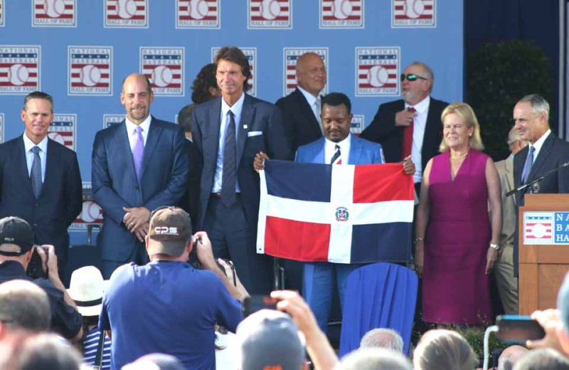 A few minutes ago at the conclusion of the 2015 Baseball Hall of Fame Induction, this year's four inductees, from left, Craig Biggio, John Smoltz, Randy Johnso and, Pedro Martinez pose with Hall Chairman Jane For bes Clark and Rob Manfred, the Rome native who succeeded Bud Selig as commissioner of basball last August.  (Ian Austin/allotsego.com)