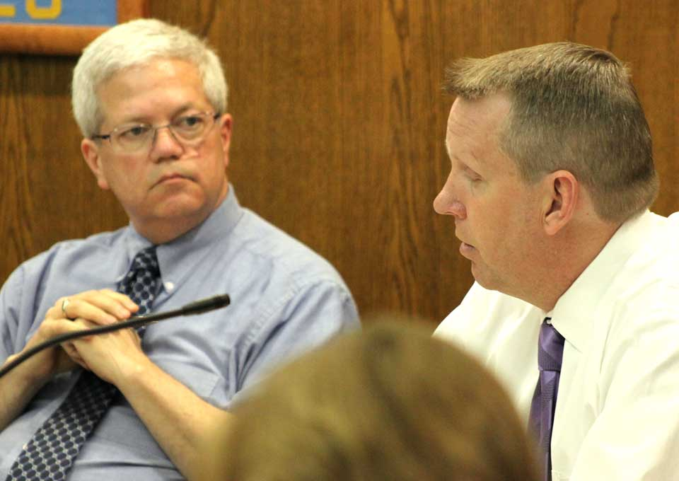 City Manager Martin Murphy listens to Council member Mike Lynch at a recent Common Council meeting.  (Ian Austin/allotsego.com)