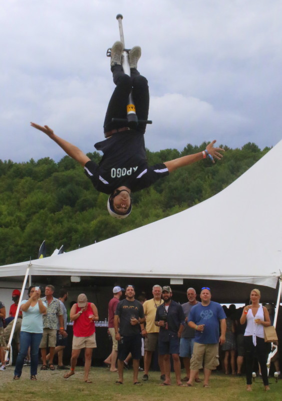 Bouncing around the Ommegang Belgian festival were several members of the Xpogo stunt team, including Mike Hugesm Grand Blanc, MI, above, who preformed gravity defying stunts for the crowds on Saturday afternoon. (Ian Austin/ allotsego.com)