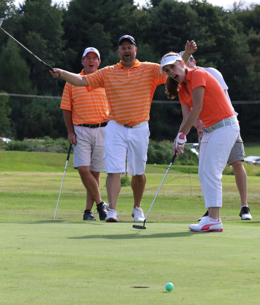 """Close, but no cigar! Cooperstowns' Matt Schuermann, Scott Whiteman and Mike Niles playfully lament as Maegan Whiteman's ball narrowly misses the 8th hole during the """"Friends Helping Friends"""" golf tournament on Saturday. The tournament, which hosted around 145 golfers at the Colonial Ridge Golf Course, is to benefit Matthew Hazzard, a central figure in Cooperstown, who was recently diagnosed with lymphoma. All in all (Ian Austin/ allotsego.com)"""