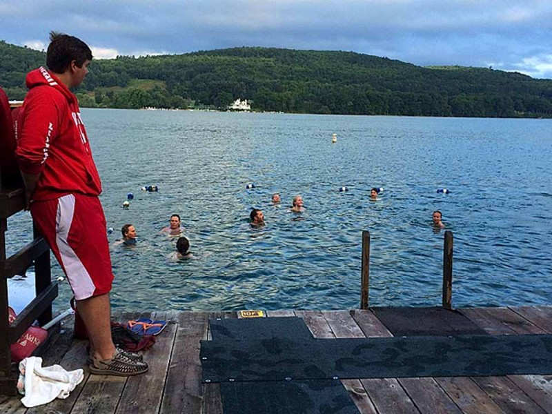 "Actually, it was considerably more then a fearless few who braved the chilly waters of Otsego Lake at 7 a.m. today at the third annual Early Bird Swim at the Village of Cooperstown's Fairy Spring Park.  A ""doggie dip"" happened at 7:17.  (Photo by Nancy Herman for allotsego.com)"