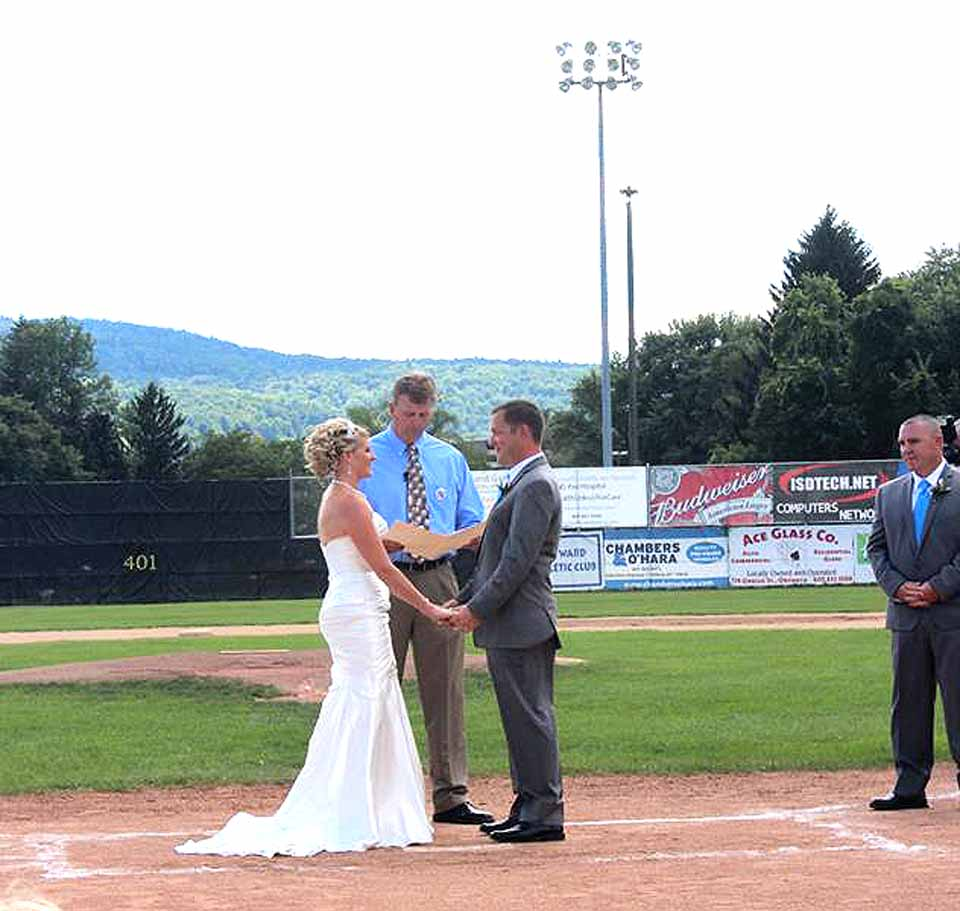 Oneonta Mayor Russ Southard performs his first wedding – Crystal and Jesse Hurlburt in Damaschke Field over the weekend.