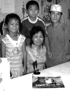 The Zhang family was photographed after their story was featured in Family Circle magazine in 2006. (allotsego.com file photo)
