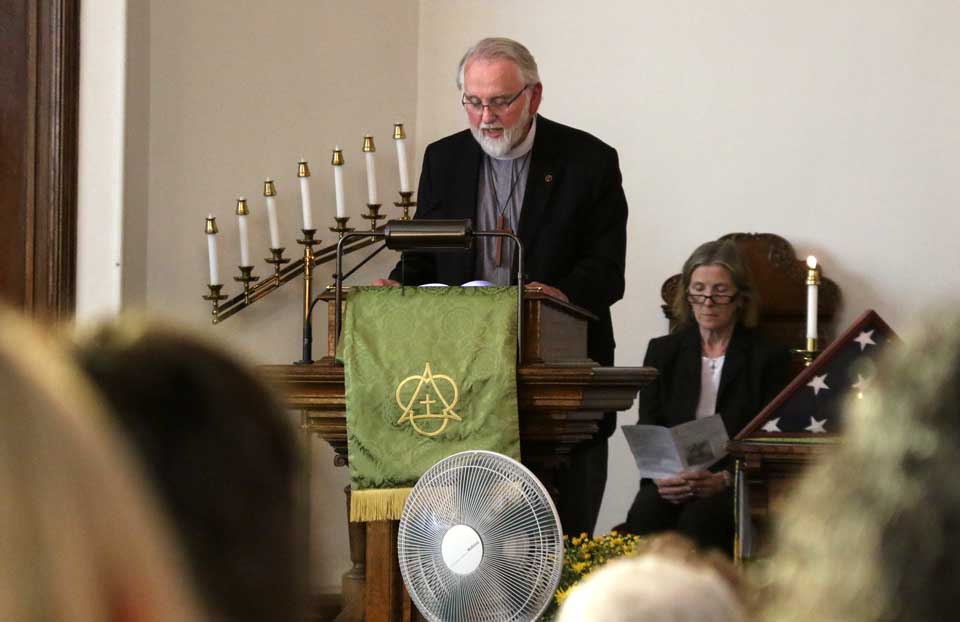 At this hour, the Rev. Bill Delia, pastor, Cooperstown United Methodist Church, leads a service of remembrance of 9/11. Today is the 14th anniversary of the World Trade Center bombing. Behind him is the Rev. Sylvia Barrett, Milford UM. (Jim Kevlin/AllOTSEGO.com)