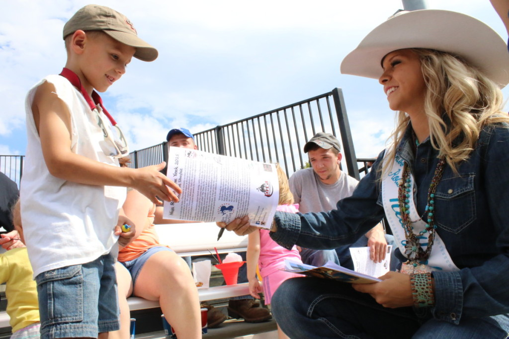 When she wasn't competing in the cattle herding or barrel racing, Miss NY Rodeo Cheyenne Shufelt was signing autographs for fans in the stands like Ethan Temming, Oneonta. (Ian Austin/AllOTSEGO.com)