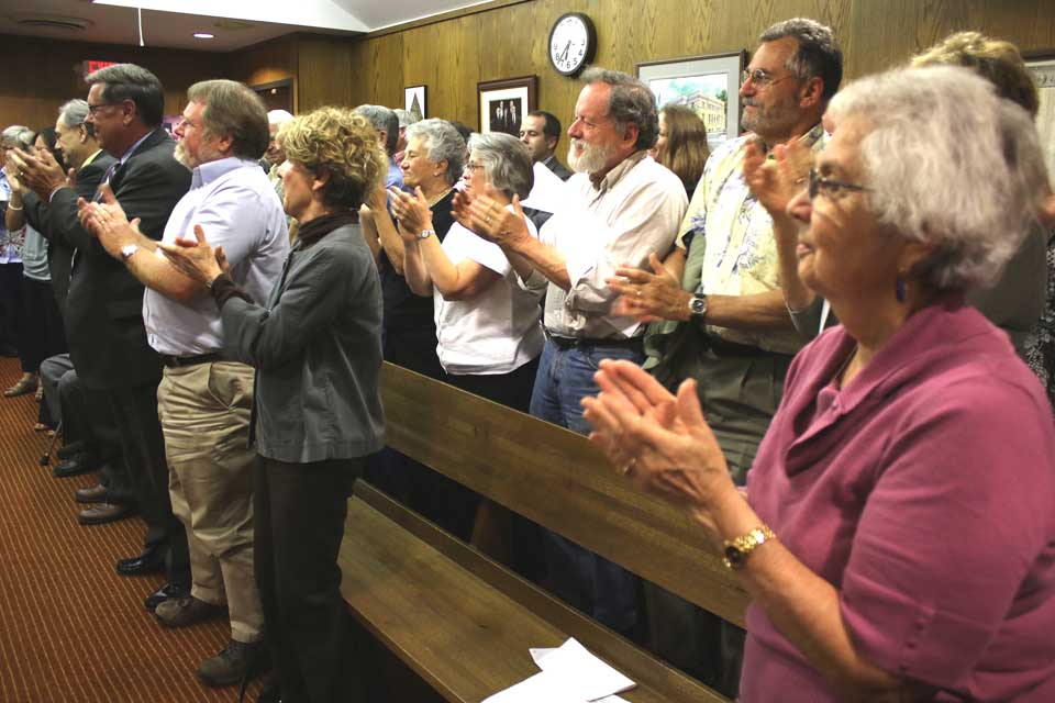 The SRO crowd leaped to its feet in applause when Judge Bernier pronounced Gary Herzig to be Oneonta's new mayor.