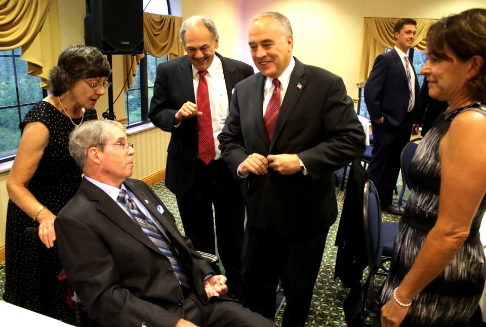 State Comptroller Tom DiNapoli chats with former county Rep. Rich Murphy, D-Oneonta, left, after arriving at the Henry J. Nicols Democratic Party Dinner a few minutes ago at the Country Inn & Suites, Hartwick Seminary. DiNapoli is the keynote speaker; Murphy is the guest of honor. Others, from left, are Murphy's wife Nancy, and former Oneonta mayors John Nader and Kim Muller. In the background is Andrew Stammel, the attorney and Oneonta Town Board member who is running for Murphy's former seat, now held by Republican Janet Quakenbush. The Jedediah Peck dinner was renamed this year in honor of Nicols, son of a former county chairman, who died of AIDS contracted from a blood transfusion in the 1980s while still a teen-ager. (Jim Kevlin/AllOTSEGO.com)