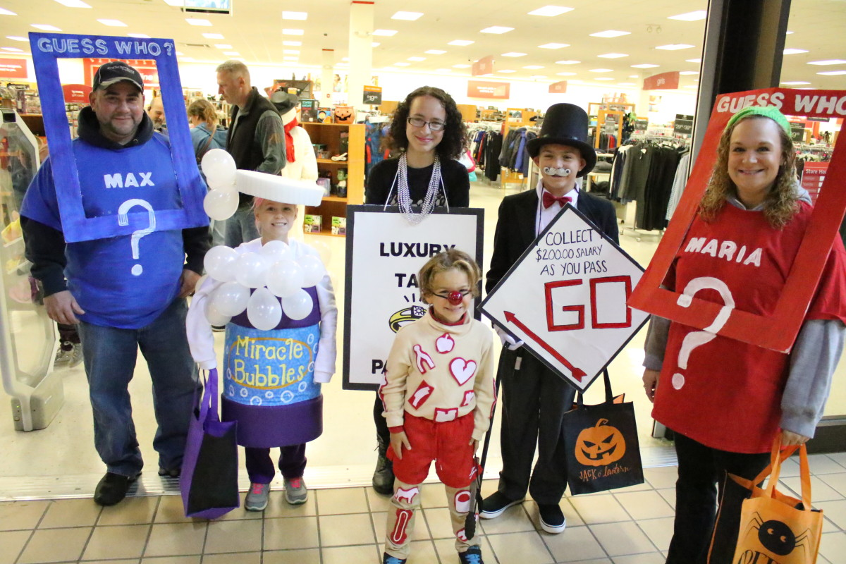 """The game is afoot! This Cherry Valley group came to to Southside Malls' Mall-O-Ween this afternoon dressed as some of our favorite childhood playthings; Paul Aramini as Guess Who Him, Mia Aramini as Miracle Bubbles, Allison Lenneacker as monopoly's Luxury Tax, Macon Aramini as Mr. Monopoly, Maddox Aramini as the Operation game man, and April Aramini as Guess Who Her. Children and their families who attended were able to enjoy trick-or-treating and carnival games before heading to the costume contest. """" (Ian Austin/AllOTSEGO.com)"""