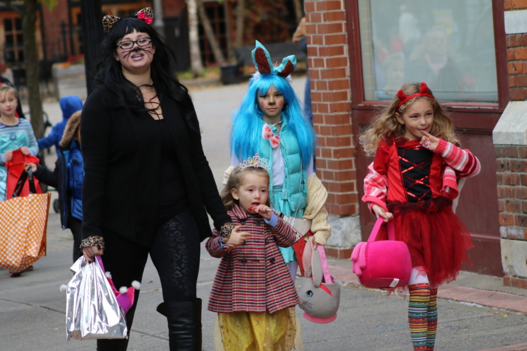 Christina Vasquez, Oneonta, trick-or-treats with her children Gaby, Anaya and Jada in downtown Onetona before the parade begins at 7pm.