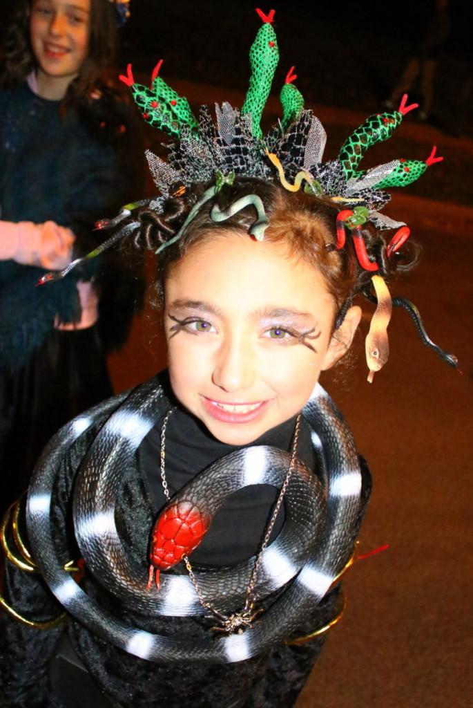Clare Capra, Oneonta, shows off her spooky home made Medusa head dress.