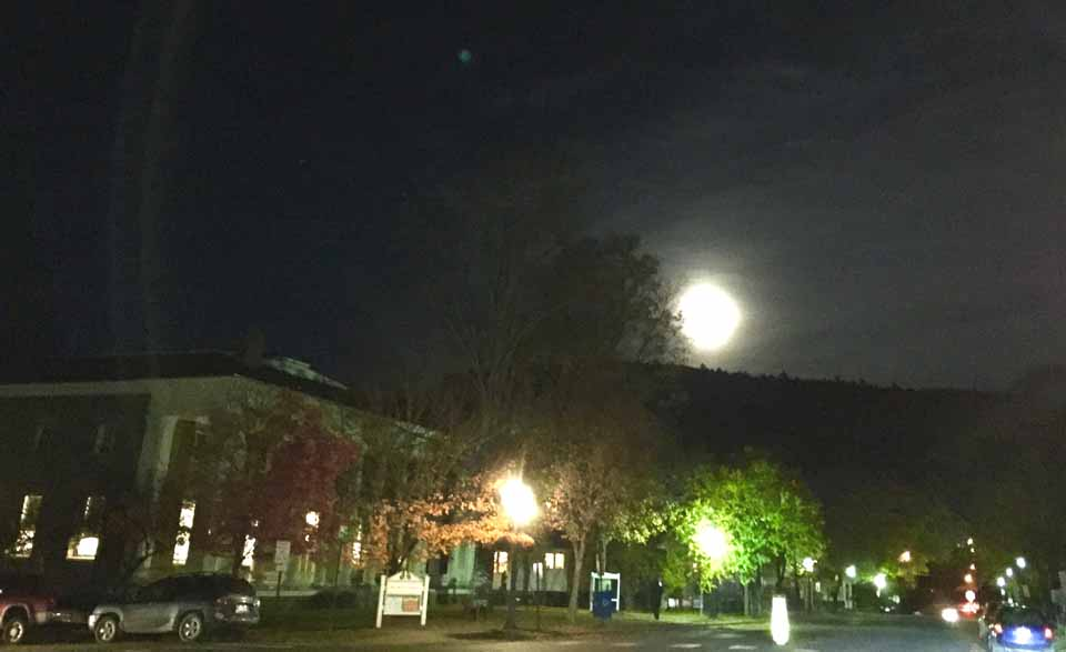 A full moon rises over 22 Main, Cooperstown's Village hall and library, last evening. Tonight, the moon will be 99 percent full, and 88 percent by Halloween, this Friday. (Tara Barnwell/AllOTSEGO.com)