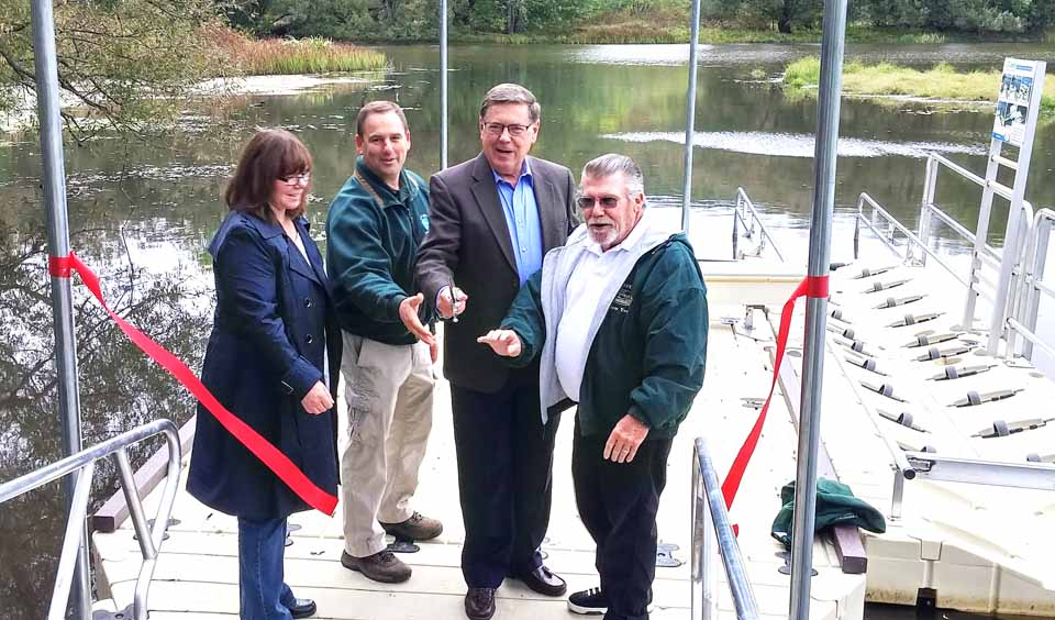 : Senator Seward helps officially dedicate the new universally accessible cartop boat launch site along the Susquehanna River in Portlandville. From left, Otsego County Conservation Association Executive Director Darla Youngs, DEC Operations Supervisor Brian Layman, Senator James Seward, Goodyear Lake Association President Dave Pickup.