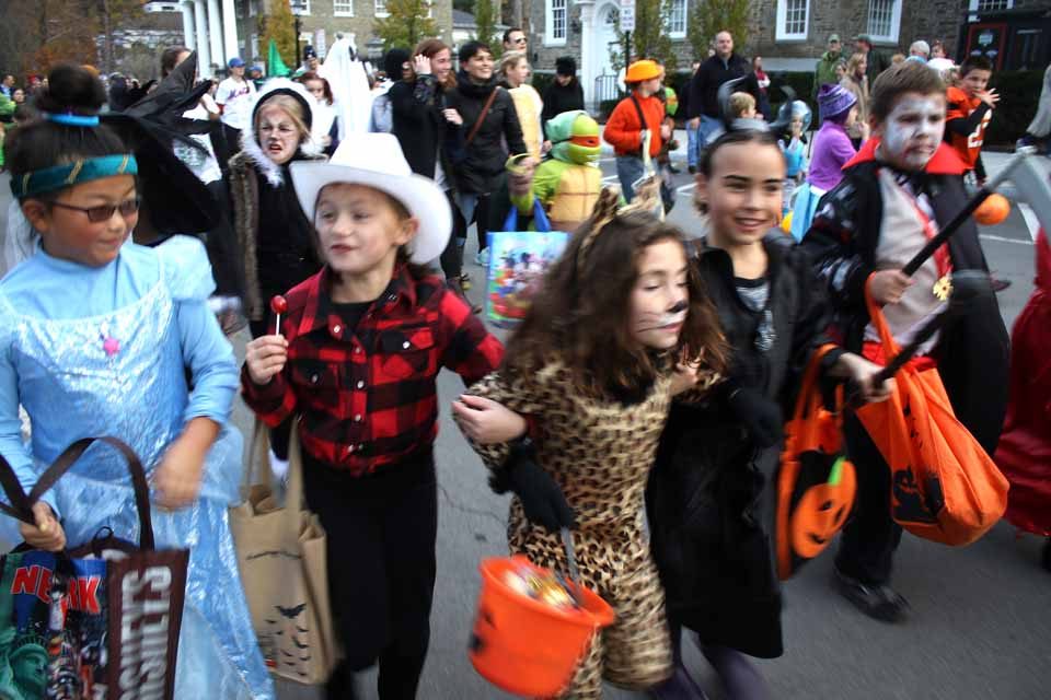 Abbie Furnari (Tarzan's Jane, maybe) grabbed her pals by the arms and led Cooperstown's Halloween Parade down Main Street this evening, right behind the CCS Marching Band. The 50-ish weather brought out an even bigger crowd than usual. (Jim Kevlin/AllOTSEGO.com)