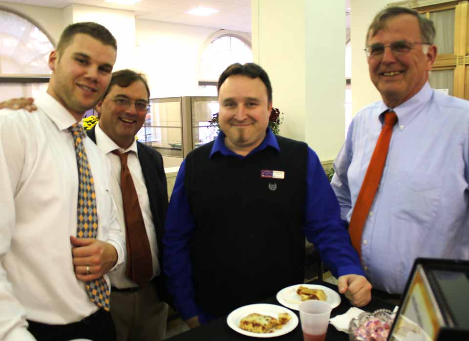 The lobby at Key Bank's Cooperstown office, 103 Main St., was full of chatter and good cheer late this afternoon as customers welcome new branch manager Allen Ruffles, left. with him are, from left, Dan Root of Hughson & Benson, Ruffles' cousin; Tony Wahl of Walh & Wahl, Milford, who went to Broome CC with Allen, and Jim Empie, who retired as branch manager over the summer. (Jim Kevlin/AllOTSEGO.com)