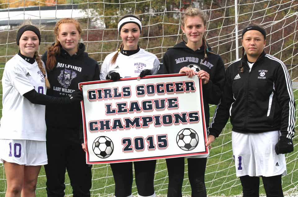 The Milford girls soccer captains (Serena Chase, Rileigh Griffiths, Mataiah Waters, Hannah Saggese and Addy LAwson) pose with their championship banner followingMCS's 6-0 win over CV-S in the Tri-Valley League title game at Oneota's Wright Campus on Saturday.