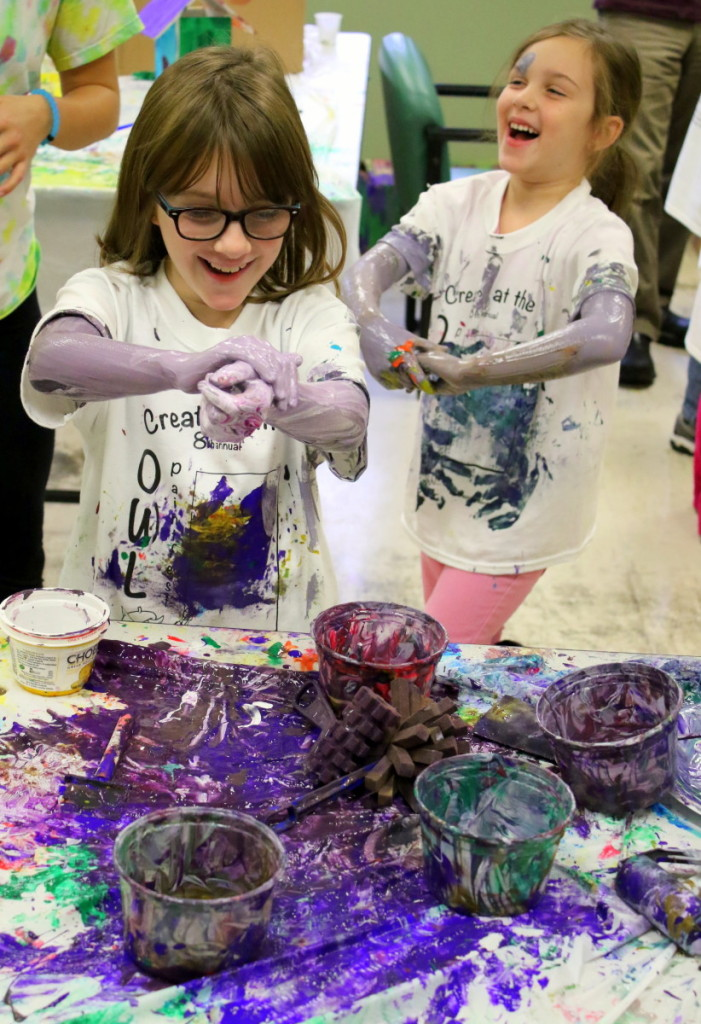 Sisters Elizabeth and Olivia Collins, Unadilla, got a little carried away and started painting themselves at OWL's 8th annual Paint Fest held this afternoon. The theme of this year's event was 'paint the town', and featured many community themed projects for children to experience from painting rocks, buildings and portraits. (Ian Austin/AllOTSEGO.com)