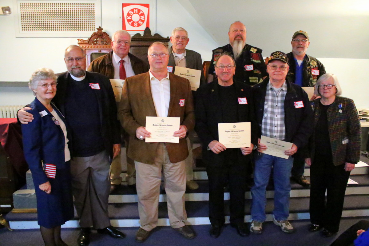 "The Daughters of the American Revolution recognized the 50th anniversary of the Gulf of Tonkin resolution that committed the U.S. to the Vietnam War by honoring area veterans with certificates of appreciation at the Masonic Temple in Oneonta this afternoon. Top row, from left, are Martin Foster, Dave Rees, Grant Coates and Joe Borawa. Front row, Cecelia Russell, Bob Wirr, Howard Trask, Neil Riddell, Don Whitmarsh and state DAR Regent Jeanne Westcott. Veterans were nominated by community members for recognition. ""They gave so much for us and didn't get much when they came home,"" said Westcott, ""It's time we turn back the clock and do it right."" (Ian Austin/AllOTSEGO.com)"