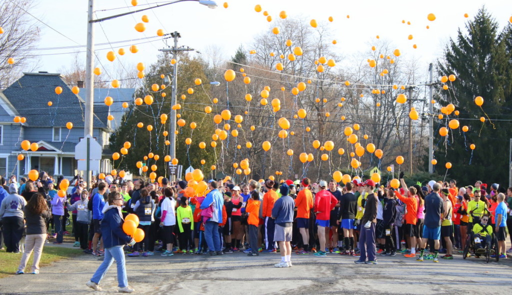 "Participants of the 3rd annual Turkey Trot wrote the names of loved ones, inspirational messages and prayers for sick or deceased family and friends on hundreds of biodegradable balloons which were released into the air before the start of the race this morning. Event organizer Kelley McGraw had attended a Turkey Trot race in Cortland and brought the idea back here and presented it to Hospice. ""They loved it and the first year we were hoping for 100 people and we ended up getting 700!"" The event, which had been gaining in numbers, boasted nearly 900 runners this morning in Oneonta's 6th ward. ""Everyone is in such a good mood when they finish the race."" McGraw said. (Ian Austin/AllOTSEGO.com)"