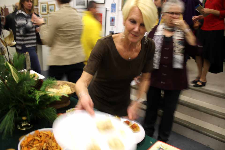 Fulfilling her duties as hostess, Cheryl Wright, Cooperstown Art Association president, refills the hors d'ouevres table at this evening's opening reception of the CAA's annual Holilday Show & Sale at 22 Main. The show, featuring, art, jewelry, fabrics and much more, is open 11 a.m.-4 p.m. daily (except Tuesdays) and 1-4 p.m. Sundays. (Jim Kevlin /AllOTSEGO.com)