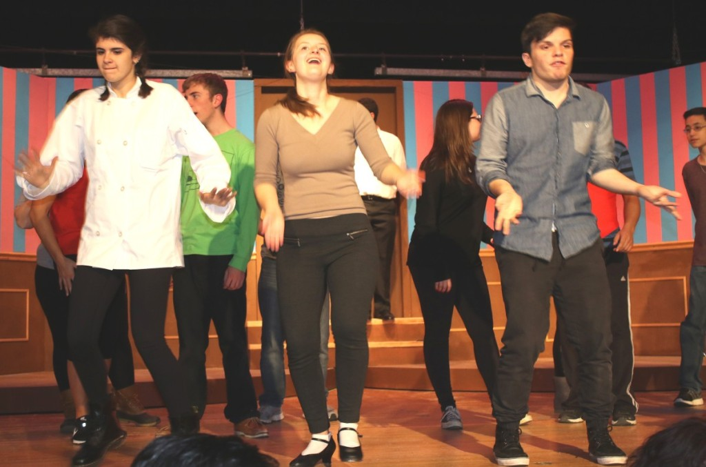"Students, from left, Alina Bischoff, Lindsay Brown and Vaughan Powers warm up in the ""Drowsy Chaperone's"" finale."