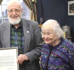 Eleanore MacDougall with her husband, Hugh, when he was honored last April for service to the village. (AllOTSEGO.com photo)