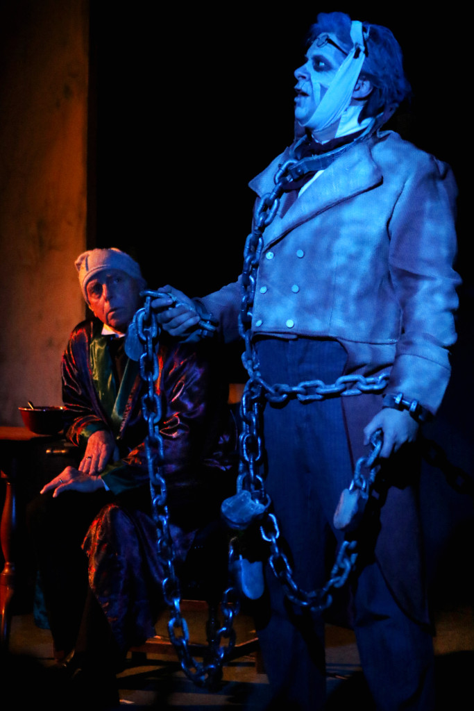"Don Raddaz takes the stage as Ebenezer Scrooge in this year's production of ""A Christmas Carol"" at The Farmers' Museum. Her the chained ghost of Jacob Marley (Michael Henrici) warns Scrooge of what will happen if he doesn't change his stingy ways. The final performance is tomorrow at 2 p.m. in the Louis B. Jones Center. (Ian Austin/ AllOTSEGO.com)"