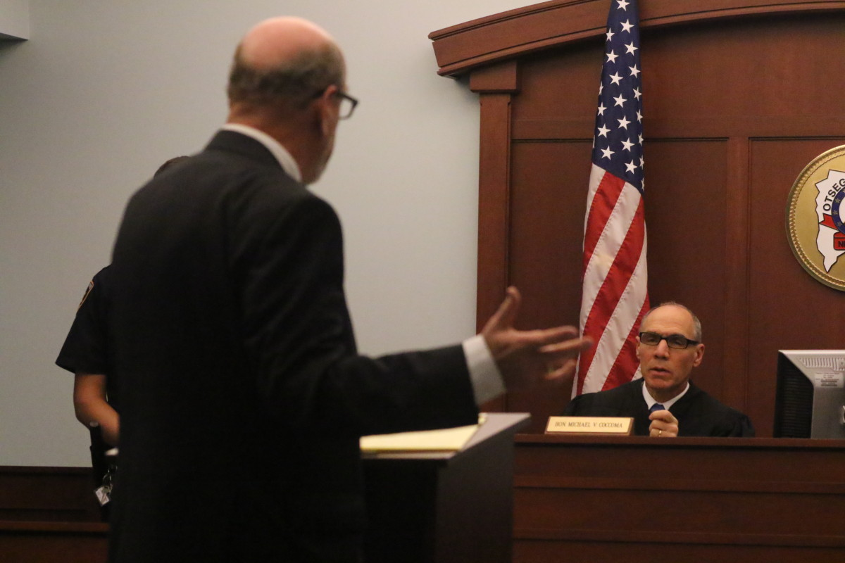 City Attorney David Merzig addresses Supreme Court Judge Michael V. Coccoma during this morning's hearing on the town and city fire contract. (Ian Austin/AllOTSEGO.com)