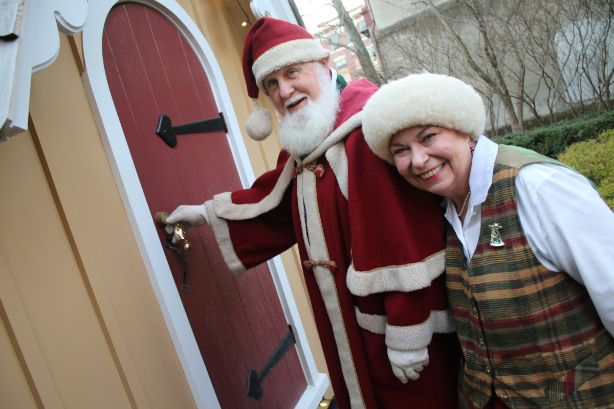 Santa and Mrs. Claus lock up the cottage in Pioneer Park, Cooperstown, in preparations to take off and deliver toys to the good boys and girls of the world. (Ian Austin/AllOtsego.com)