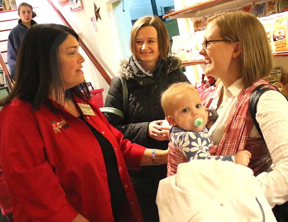 """Brenda Michaels, owner of the Fly Creek Cider Mill, talks with Emily Ryan, who came from Erieville to rally moms at a """"Nurse-In"""" at the Fly Creek Cider Mill. """"I nursed my daughter here,"""" said Michaels. """"We are a family-friendly store."""" The nurse-in, which was attended by a half-dozen moms, had been prompted by a Facebook post in which a nursing mother was asked to cover up at the store. An apology was issued by Michaels on Facebook shortly after the incident. (Ian Austin/AllOTSEGO.com)"""