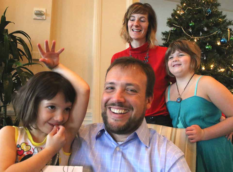 County Rep.-elect Andrew Marietta share a laugh with wife Melissa and daughters Caroline, 9, and Charlotte, 5, during Breakfast With Santa Sunday, Dec. 13, at The Otesaga. (Jim Kevlin/AllOTSEGO.COM)