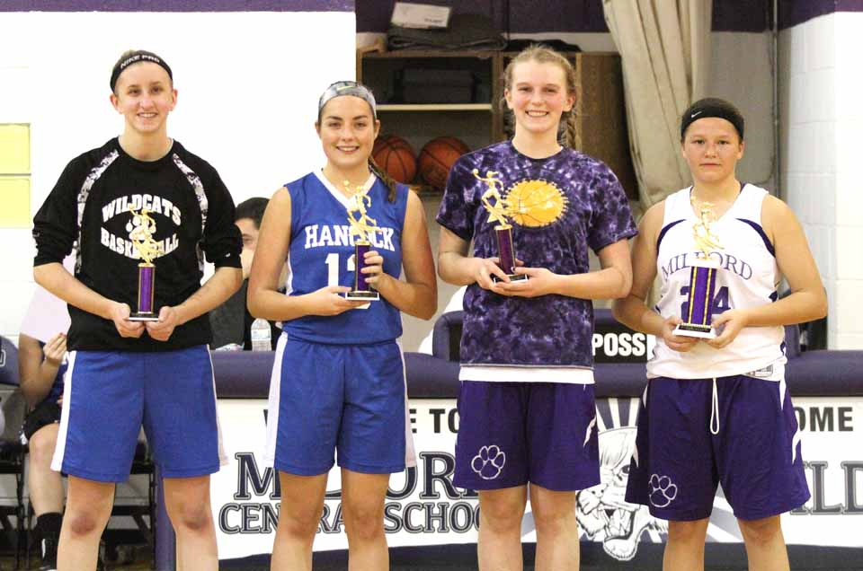 MVP Addy Lawson of Milford, right, is joined by, from left, Lexi Houghton (Hancock), Ashley Drake (Hancock) and Maddy Zenir (Milford), after the Milford girls won the championship game, 56-46, Saturday at the 2015 Anton Remy Tournament, hosted at Milford. (Cheryl Clough/AllOTSEGO.com)