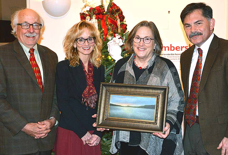Joseph and Martha Membrino of Cooperstown won an oil painting of the Sleeping Lion, the Otsego Lake landmark, at NYSHA's annual Holiday Members' Reception Sunday evening at The Fenimore Art Museum. The Membrimos were randomly chosen from a group of 200 members who recently completed an extension survey on the museum. From left are Joseph Membrino, artist Susan Jones Kenyon, Martha Membrino and Dr. Paul S. D'Ambrosio, NYSHA president. (Fenimore Art Museum photo)