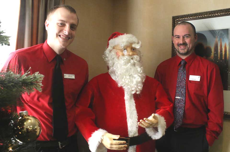 There was no memo. Zack Telfer of Fly Creek, left, and Jay Beecher of Milford both, coincidentally, showed up for work today at the Country Inn & Suites, Hartwick Seminary, wearing the color of the season. They pose with another guy in the lobby who was similarly in the spirit of the season. (Jim Kevlin/AllOTSEGO.com)