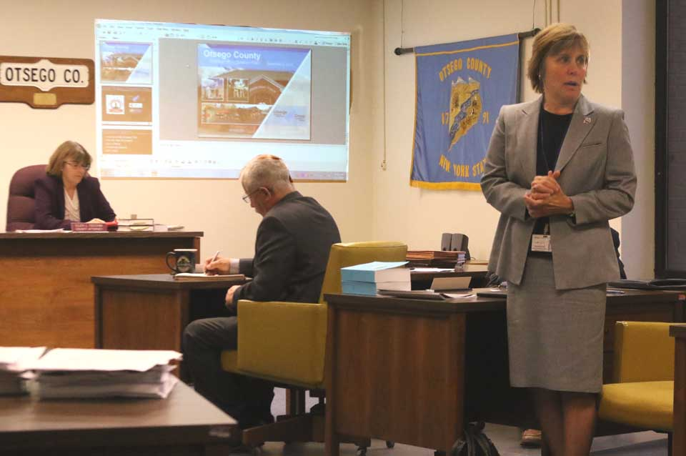 A tearful county Rep. Linda Rowinski, D-Oneonta, bids farewell to her colleagues, friends and voters this morning at her final meeting of the county Board of Representatives. Five county reps are leaving the board at year's end: Rowinski, Janet Hurley Quakenbush, R-Town of Oneonta; Ed Lentz, D-New Lisbon; Don Lindberg, R-Worcester; Rick Hulse, R-Fly Creek, Betty Anne Schwerd, R-Edmeston. Beth Rosenthal, D-Roseboom, had resigned in October and moved to Albany. (Jim Kevlin/AllOTSEGO.com)