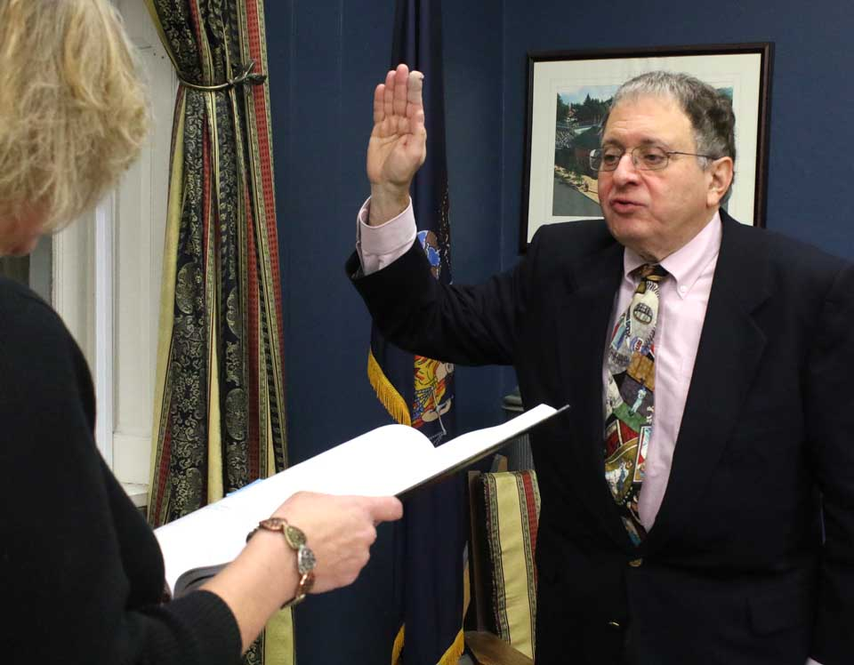 Dr. Richard Sternberg, the recently retired Bassett Hospital orthopedic physician, takes the oath of office this evening and joined the Cooperstown Village Board. He was appointed by Mayor Jeff Katz to fill the vacancy left by Joan Nicols resignation; he will have to run for a full term in March. Village Clerk Teri Barown administers the oath. (Jim Kevlin/AllOTSEGO.com)
