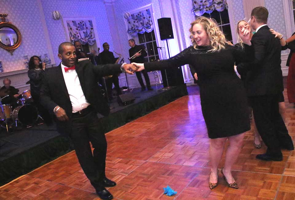 Felix Thomas, Oneonta, dips his wife Lauren on the dance floor to the sounds of the band Chaser, who kept the final hours of 2015 hopping at Bassett Hospital's annual New Year's Eve Gala, still hoppin' at the Otesaga in Cooperstown. The festivities end at midnight with fireworks. (Ian Austin/AllOTSEGO.com)