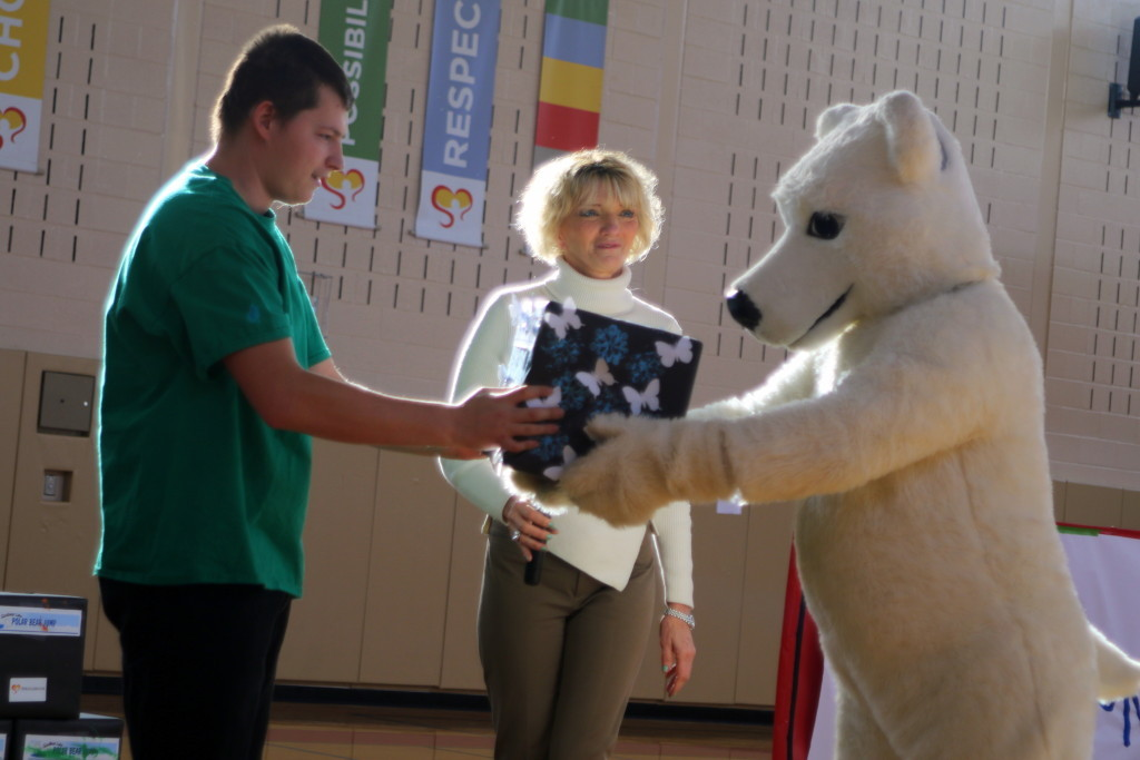 Springbrook has been named as one of the recipients of this year's Polar Bear Jump! In appreciations, Springbrook students, including Matt Wagner, left, Franklin, decorated donation boxes and presented them to Goody, the jump's mascot, at a pep-rally this afternoon at Springbrooks main campus. Patricia Kennedy, center, Chief Executive Officer at Springbrook, challenged Seth Haigt t take the plunge next month, but it remains to be seen if that challenge will be accepted! (Ian Austin/ AllOTSEGO.com)