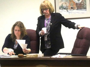 Kathy Clark, R-Otego, retakes her usual seat at the front of County Board chambers after her unanimous reelection. At left is Carol McGovern, clerk of the board.