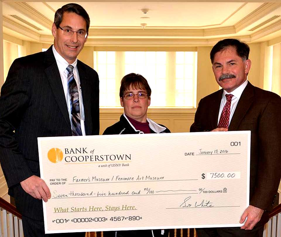 On Wednesday, Bank of Cooperstown presented a check for $7,500 to The Farmers' Museum and Fenimore Art Museum to generously sponsor 2016 educational programming, Tractor Fest and Sugaring Off Sundays. Scott White (left), President of Bank of Cooperstown, assisted by Branch Supervisor, Peggy Pashley, presented the check to the President and CEO of the museums, Dr. Paul S. D'Ambrosio.