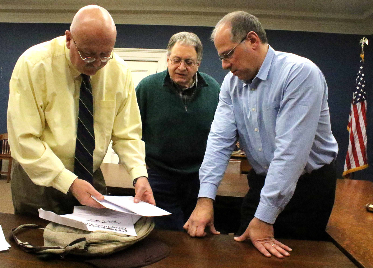 Cooperstown Mayor Jeff Katz, right, was nominated for a third term on the village's helm at the Democratic caucus this evening in Village Hall. Also nominated were incumbent trustees David Maxson, left, and Richard Sternberg. Village Republicans failed to hold a caucus, so – absent an independent challenge – the three nominees, who in the photo are filling out the required paperwork, will be affirmed in the March 15 village elections. (Jim Kevlin/AllOTSEGO.com)