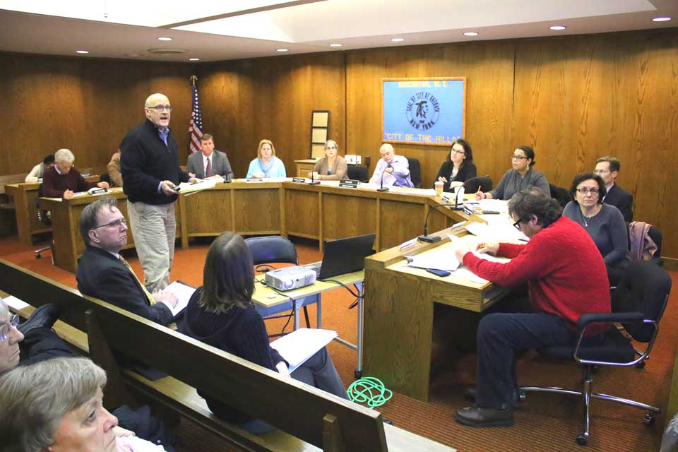 """After a year of turmoil in City Hall, a newly elected Common Council (six of the eight members are new, plus a new mayor) convened tonight with good cheer and got good news: Jim Martin, a consultant with the LA Group, Saratoga Springs, who has been collecting information on downtown Oneonta, gave preliminary results and said """"there is much to build on."""" Listening from left are Council members John Rafter, John Ficano (behind Martin), Russ Southat"""