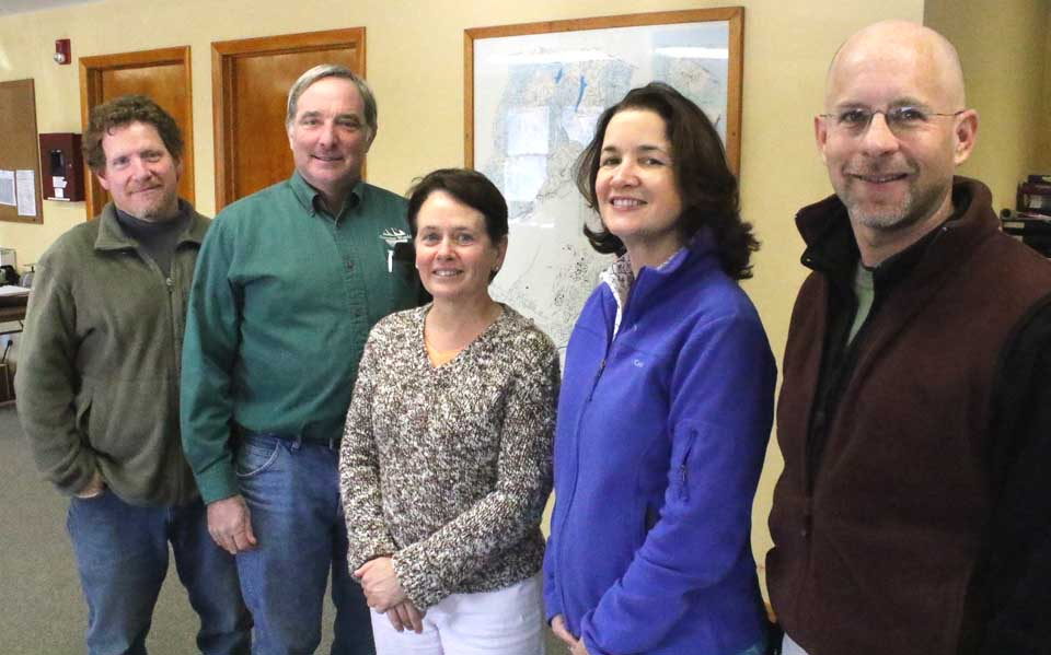 Newly elected Otsego Town Supervisor Meg Kiernan and Town Board member Joe Potrikus joined their Otsego Town Board colleagues at 12:30 p.m. today for the organizational meeting. From left are Town Board member Bennett Sandler, Potrikus, Kiernan, and Town Board members Karina Franck and Tom Hohensee. Town Clerk Pam Deane conducted Potrikus' swearing-in; Kiernan had taken the oath of office on New Year's Day. The new supervisor also provided lunch – homemade ham-salad sandwiches – for the gathering. (Jim Kevlin/AllOTSEGO.com)
