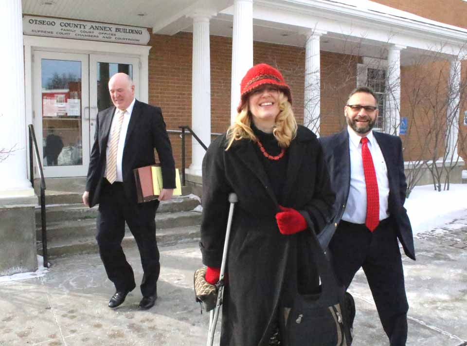Town of Oneonta Fire Commissioners Johna Peachin, center, and Fred Volpe, right, exit state Supreme Court in Cooperstown shortly afternoon with the district's lawyer, Terrence Hannigan, to discuss a possible settlement to the fire-protection standoff with the city. (Jim Kevlin/AllOTSEGO.com)