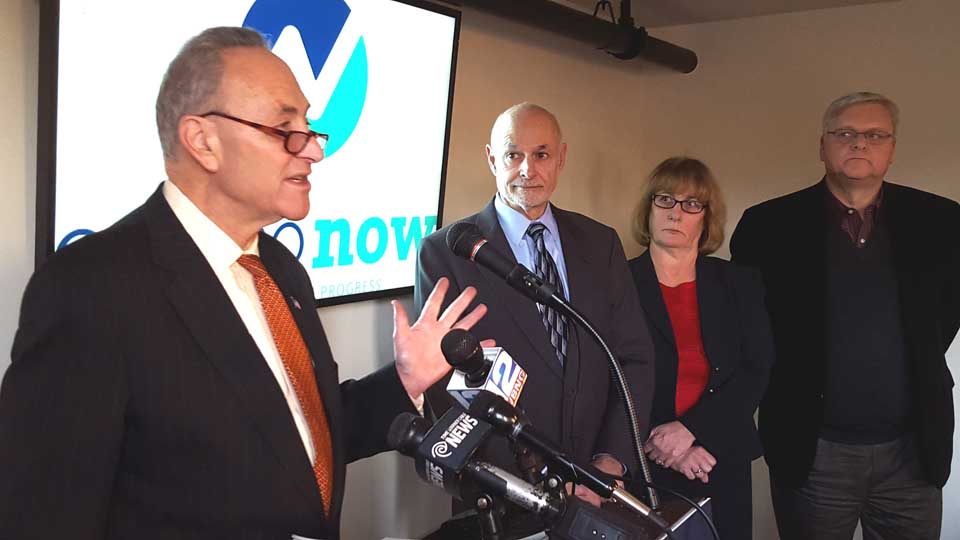 U.S. Sen. Chuck Schumer, D-N.Y., is in Oneonta at this hour, about to tour sites of the prospective Upper Susquehanna Agricultural Center and entertainment district planned at Market and Chestnut streets, around Foothills Performing Arts Center. Here, Schumer makes preliminary remarks at Otsego Now's headquarters on the fifth floor of 189 Main. At right are Mayor Gary Herzig, county Board Chair Kathy Clark, R-Otego, and Otsego Now President Sandy Mathes. (Ian Austin/AllOTSEGO.com)