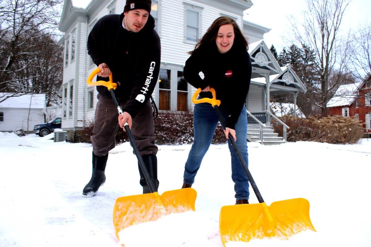 It was in the teens this afternoon, but Dayna Vibbard made the best of it, helping her boyfriend, Tom Reddick of Stretch's Lawn Care, shovel the walk around Schlather & Birch, Cooperstown. In addition to temperatures in the single digits tonight across Otsego County, there's a lake-effect advisory in effect until 10 a.m. Tuesday. (Jim Kevlin/AllOTSEGO.com)