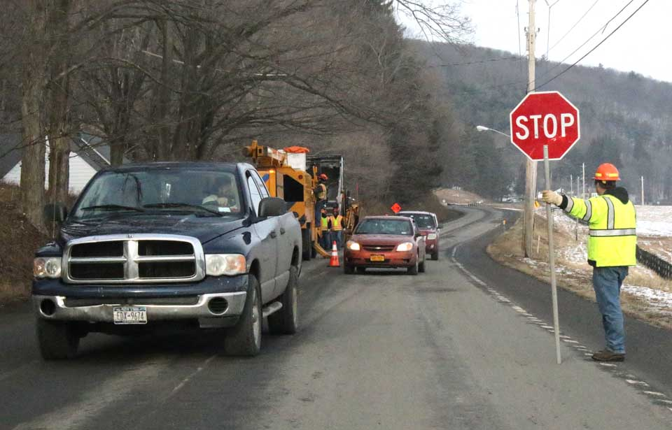 Traffic was down to one lane on Route 29 south of Cooperstown this afternoon as county road crews cut back trees in the vicinity of the Clark Foundation Scholarship Office. (AllOTSEGO.com photo)