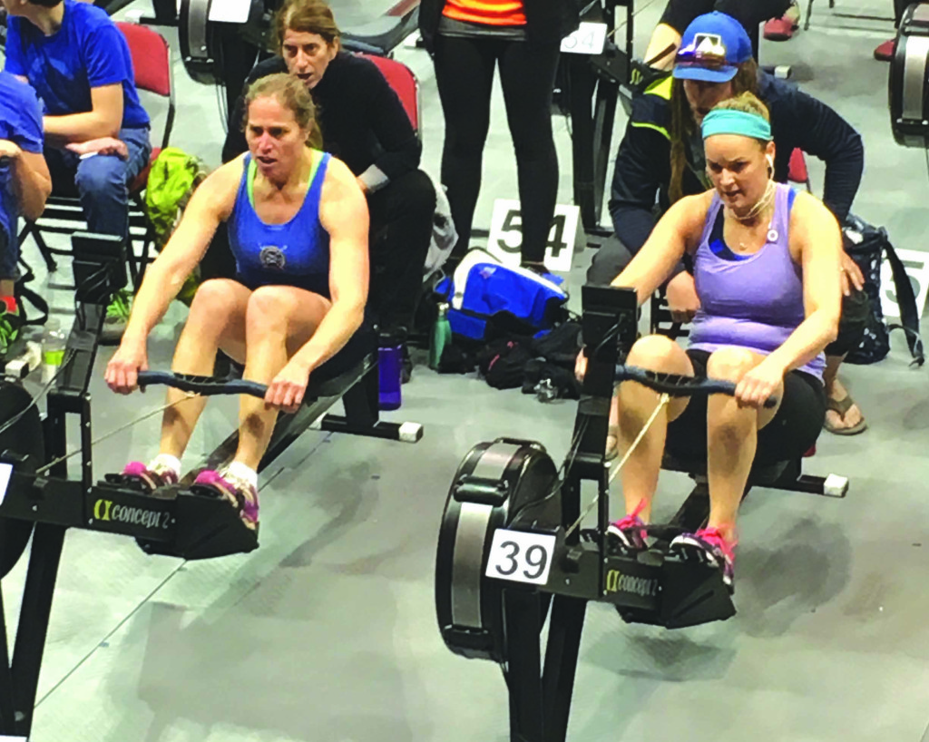 Andrea Thies, in blue, placed fourth in the World Rowing Machine Competition.