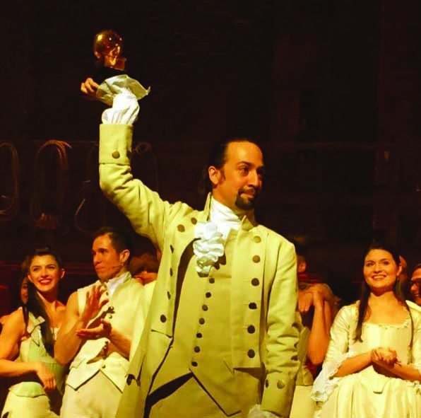 "Carleigh Bettiol, back left, performed the opening number ""Alexander Hamilton"" with the cast of the broadway smash hit'Hamilton' at last night's Grammy Awards. Star and writer Lin-Manuel Miranda holds up the Grammy that the cast took home for ""Best Musical Theater Album"""