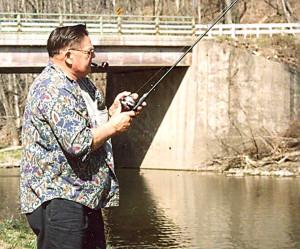 Ray Winchester fishing at his camp near Wells Bridge.